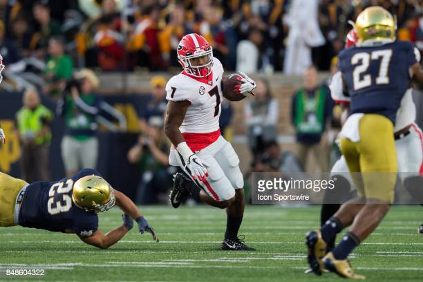 Georgia Bulldogs running back D'Andre Swift runs by Notre Dame Fighting Irish linebacker Drue Tranquill during the college football game between the...
