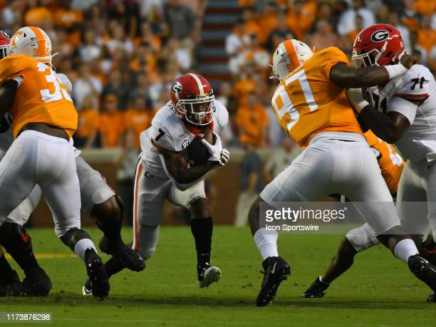 Georgia Bulldogs Running Back D'Andre Swift rushes the ball during the game between the Georgia Bulldogs and the Tennessee Volunteers on October 05...