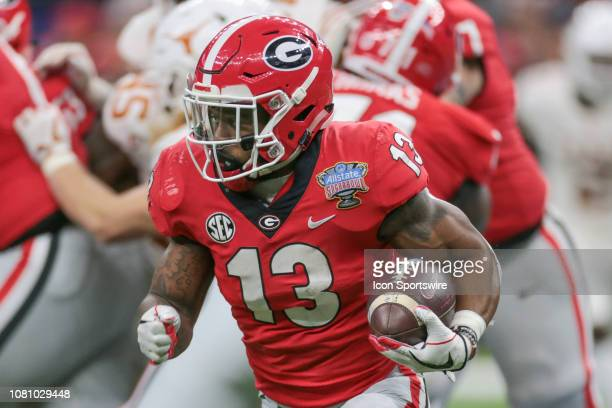 Georgia Bulldogs running back Elijah Holyfield carries around the end during the Allstate Sugar Bowl game between the Georgia Bulldogs and the Texas...
