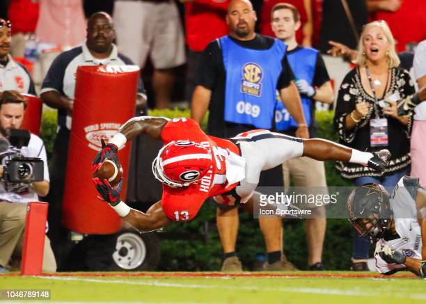Georgia Bulldogs running back Elijah Holyfield dives into the end zone to score a touchdown during the Vanderbilt Commodores v Georgia Bulldogs game...