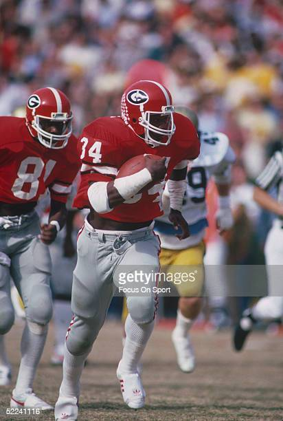 Georgia Bulldogs' running back Herschel Walker runs with the ball during a circa 1980s game