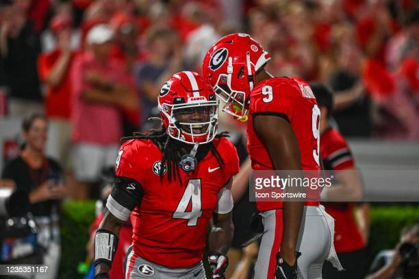 Georgia Bulldogs running back James Cook celebrates his touchdown with wide receiver Justin Robinson during the NCAA football game between the South...