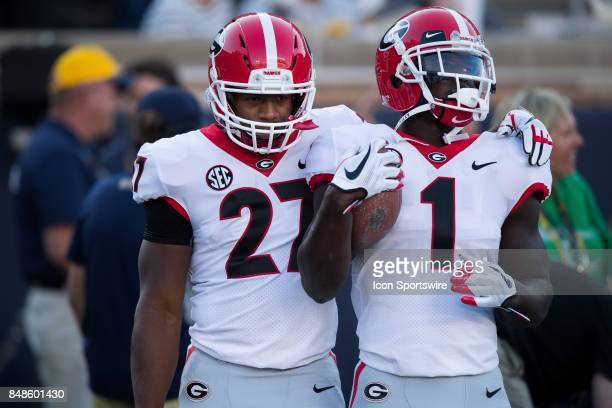 Georgia Bulldogs running back Nick Chubb and Georgia Bulldogs running back Sony Michel warm up on the field before the college football game between...