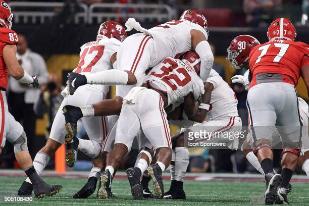 Georgia Bulldogs running back Nick Chubb is tackled by Alabama Crimson Tide linebacker Rashaan Evans Alabama Crimson Tide linebacker Christian Miller...