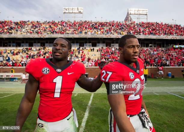 Georgia Bulldogs running back Sony Michel and running back Nick Chubb walk off the field together at the conclusion of the Georgia Bulldogs v Georgia...