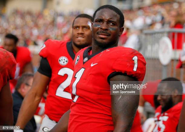 Georgia Bulldogs running back Sony Michel and running back Nick Chubb watch on from the sideline during the Georgia Bulldogs v Georgia Tech Yellow...
