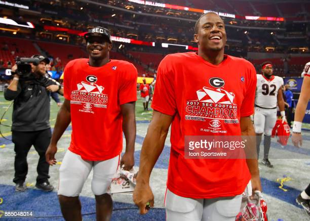 Georgia Bulldogs running back Sony Michel and running back Nick Chubb walk off the field at the conclusion of the SEC Championship Game between the...