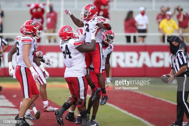 Georgia Bulldogs running back Zamir White celebrates a touchdown during the football game between the Arkansas Razorbacks and the Georgia Bulldogs on...