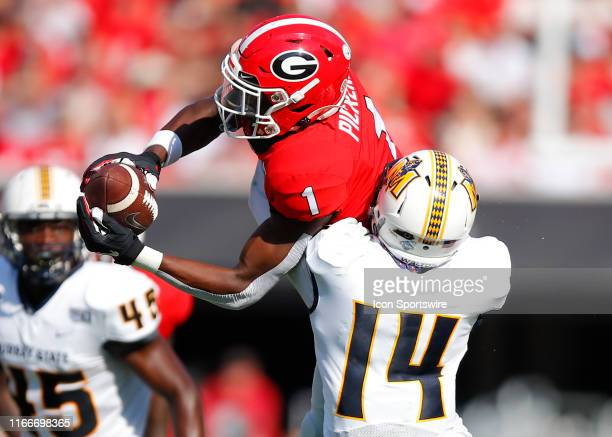 Georgia Bulldogs wide receiver George Pickens makes a leaping catch over Murray State Racers defensive back Nigel Walton in the first half of the...