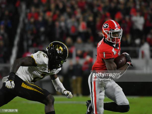 Georgia Bulldogs Wide Receiver George Pickens rushes the ball as Missouri Tigers Defensive Back DeMarkus Acy pursues during the game between the...