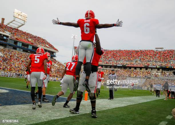 Georgia Bulldogs wide receiver Javon Wims celebrates a touchdown with offensive tackle Kendall Baker during the Georgia Bulldogs v Georgia Tech...