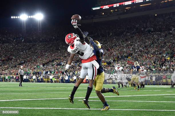 Georgia Bulldogs wide receiver Terry Godwin beats Notre Dame Fighting Irish linebacker Robert Regan to catch a one handed pass for a touchdown during...