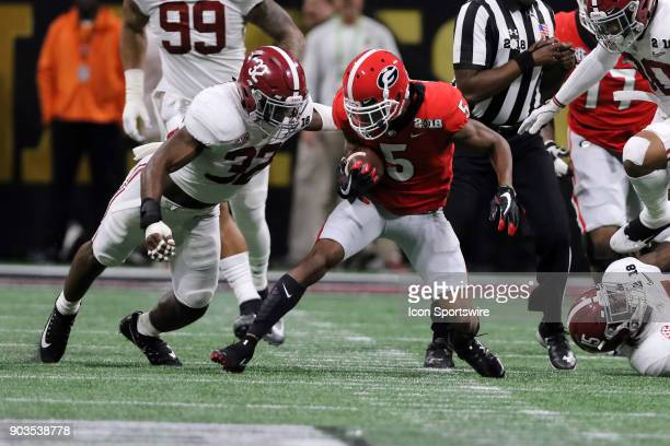 Georgia Bulldogs wide receiver Terry Godwin is defended by Alabama Crimson Tide linebacker Rashaan Evans during the College Football Playoff National...