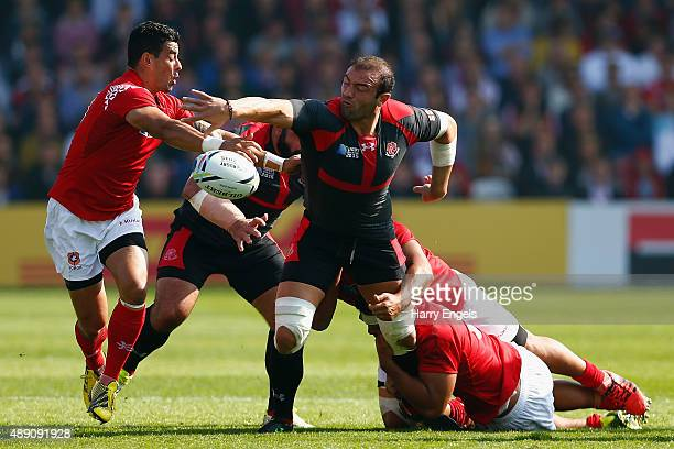 Georgia captain Mamuka Gorgodze is tackled by the Tonga defence during the 2015 Rugby World Cup Pool C match between Tonga and Georgia at Kingsholm...