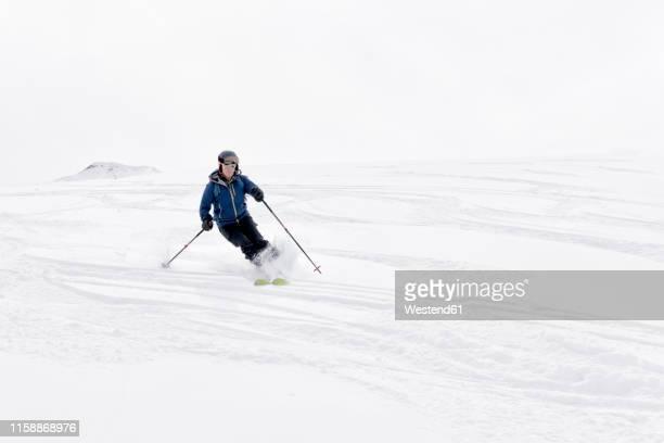 georgia, caucasus, gudauri, man on a ski tour riding downhill - alpine skiing stock pictures, royalty-free photos & images