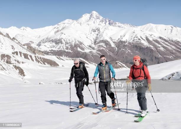 georgia, caucasus, gudauri, people on a ski tour - skiing stock pictures, royalty-free photos & images