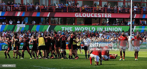Georgia celebrate their win over Tonga during the 2015 Rugby World Cup Pool C match between Tonga and Georgia at Kingsholm Stadium on September 19...