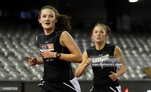 Georgia Clarke performs in the 2km time trial during the AFLW Draft Combine at Marvel Stadium on October 3 2018 in Melbourne Australia