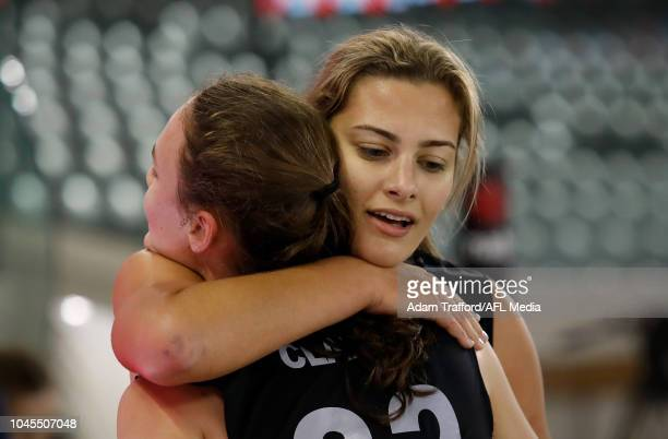 Georgia Clarke recovers after the 2km time trial with Lauren Bella during the AFLW Draft Combine at Marvel Stadium on October 3 2018 in Melbourne...