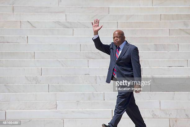 Georgia Congressman John Lewis waves at the National Action to Realize the Dream march and rally for the 50th Anniversary of the march on Washington...