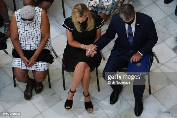 Georgia Covernor Brian Kemp and First Lady Marty Kemp bow their heads in prayer as the body of civil rights leader C.T. Vivian lies in state in the...