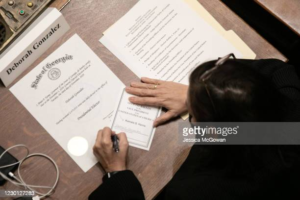 Georgia Democratic Elector Deborah Gonzalez signs a paper ballot solidifying her Electoral College vote for Kamala Harris as Vice President of the...