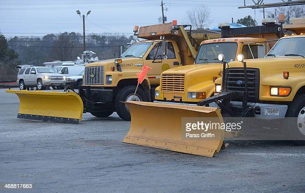 Georgia Department of Transportation plows and spreader trucks dispatch from Cheshire Bridge Road location on February 11 2014 in Atlanta Georgia...