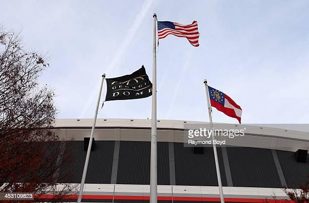 Georgia Dome Flag, American Flag and the Georgia State Flag, flies outside the Georgia Dome, home of the Atlanta Falcons football team in Atlanta,...