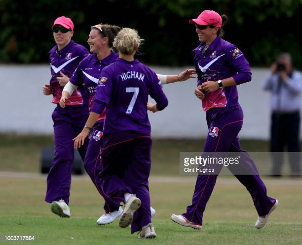 Georgia Elwiss of Loughborough Lightning celebrates with her teammates after taking a catch to dismiss Emma Lamb of Lancashire Thunder during the Kia...