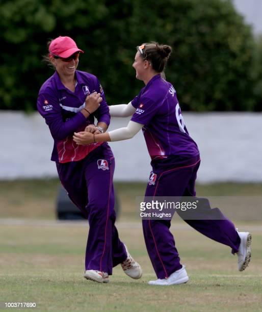 Georgia Elwiss of Loughborough Lightning celebrates with teammate Lindsey Smith after taking a catch to dismiss Emma Lamb of Lancashire Thunder...