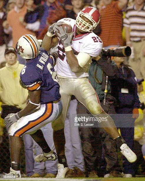 Georgia flanker Michael Johnson #25 catches the winning touchdown pass against Auburn defensive back Horace Willis late in the fourth quarter on...