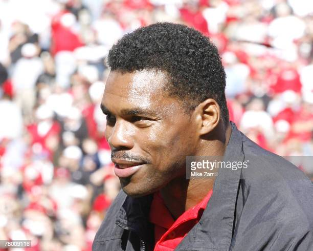 Georgia football great Herschel Walker attended the 1980 championship team ceremony during the game versus Kentucky at Sanford Stadium in Athens,...