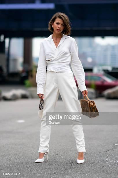 Georgia Fowler is seen wearing a Jaquemus shirt Alberta Ferretti pants Schutz shoes with Bagatiba jewelry Vintage Fendi handbag and Oliver Peoples...