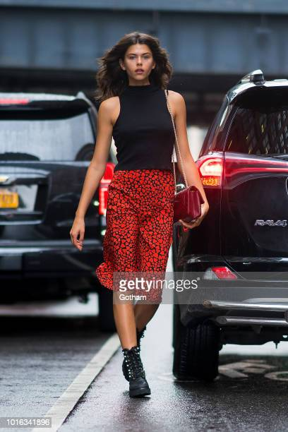 Georgia Fowler is seen wearing a Topshop shirt Realisation Par skirt Altuzurra boots with a Chanel handbag in Chelsea on August 13 2018 in New York...