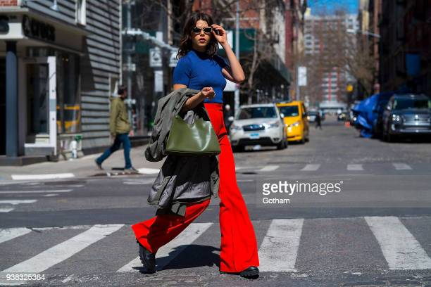 Georgia Fowler is seen wearing Khaite pants an Une Heures top with an Elleme handbag Bec Bridge sunglasses and Altuzarra boots in SoHo on March 26...
