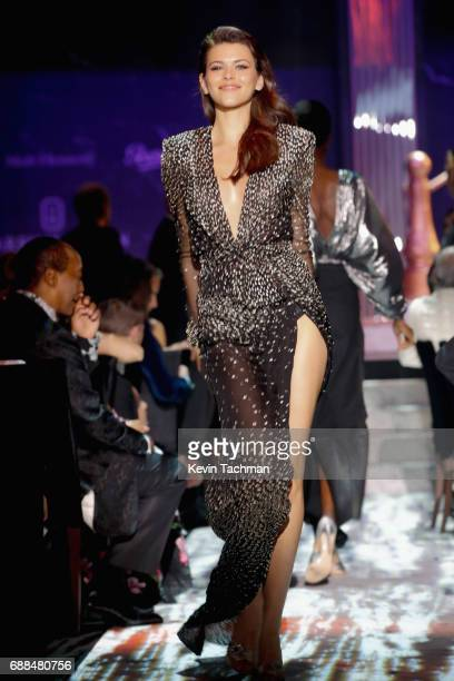 Georgia Fowler walks the runway at the amfAR Gala Cannes 2017 at Hotel du CapEdenRoc on May 25 2017 in Cap d'Antibes France