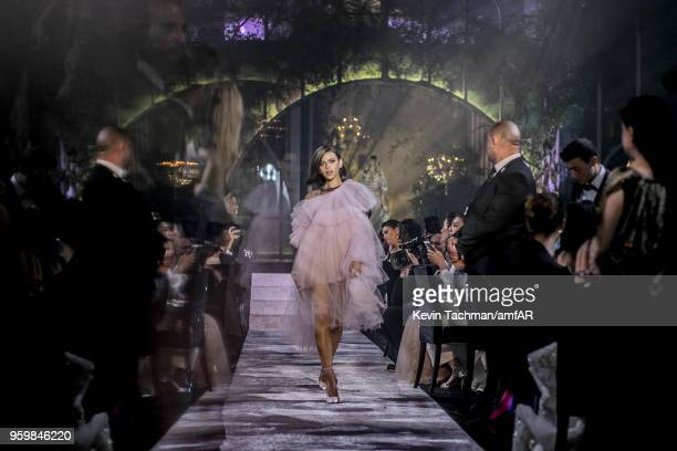 Georgia Fowler walks the runway during the amfAR Gala Cannes 2018 fashion show at Hotel du CapEdenRoc on May 17 2018 in Cap d'Antibes France