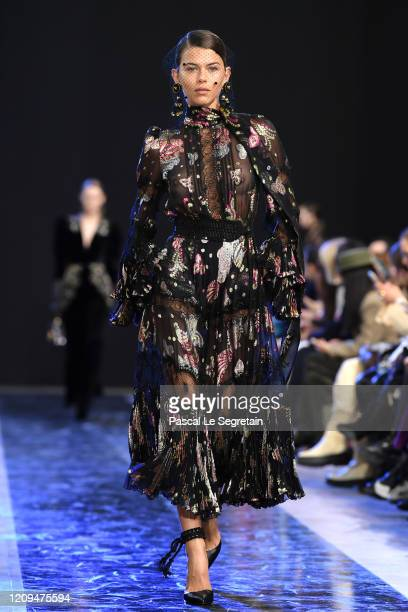 Georgia Fowler walks the runway during the Elie Saab show as part of the Paris Fashion Week Womenswear Fall/Winter 2020/2021 on February 29, 2020 in...