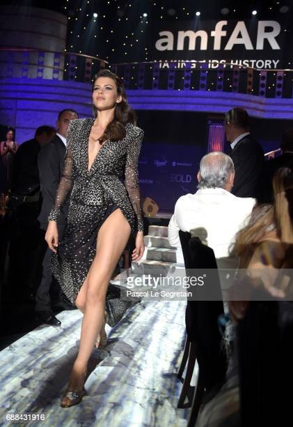 Georgia Fowler wearing Redemption walks the runway in the fashion show during the amfAR Gala Cannes 2017 at Hotel du CapEdenRoc on May 25 2017 in Cap...
