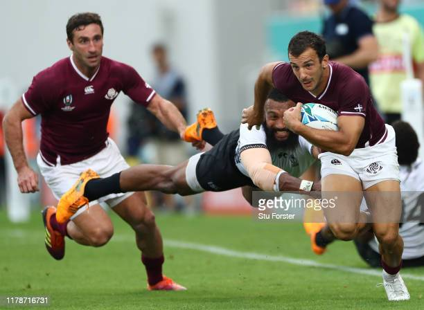 Georgia fullback Soso Matiashvili escapes the diving tackle of Waisea Nayacalevu during the Rugby World Cup 2019 Group D game between Georgia and...