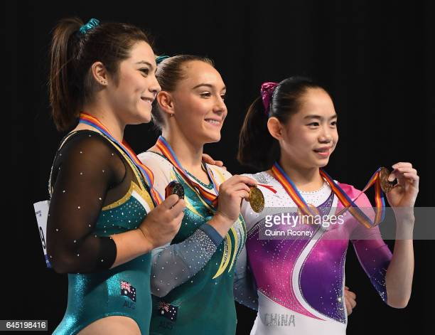 Georgia Godwin of Australia Emily Little of Australia and Tingting Liu of China pose on the podium after the Floor aparatus during the World Cup...