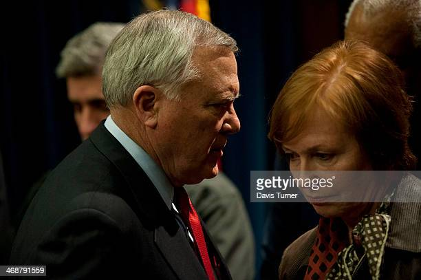 Georgia Gov Nathan Deal talks to Brenda Fitzgerald Commissioner of the Georgia Department of Public Health during a news conference at the Capitol...