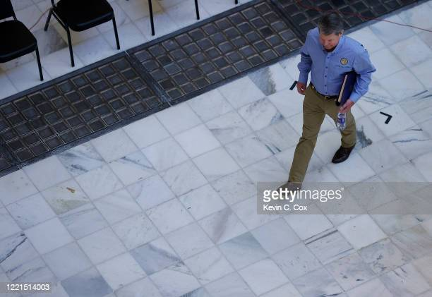 Georgia Governor Brian Kemp arrives to speak the media at a press conference at the Georgia State Capitol on April 27 2020 in Atlanta Georgia The...