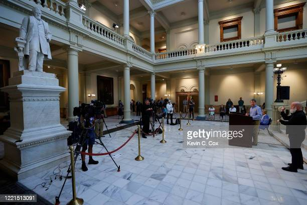 Georgia Governor Brian Kemp speaks to the media during a press conference at the Georgia State Capitol on April 27 2020 in Atlanta Georgia The press...
