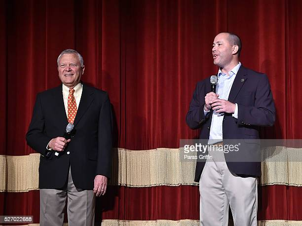 Georgia Governor Nathan Deal and Georgia Department of Economic Development Commissioner Chris Carr speak onstage at 'Captain America Civil War'...