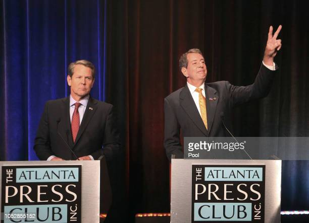 Georgia gubernatorial candidate Libertarian Ted Metz acknowledges supporters as Republican Brian Kemp looks on before a debate that also included...