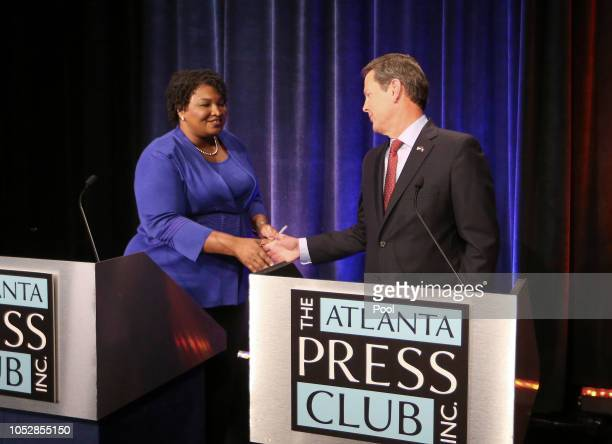 Georgia gubernatorial candidates Democrat Stacey Abrams and Republican Brian Kemp shake hands before a debate that also included Libertarian Ted Metz...