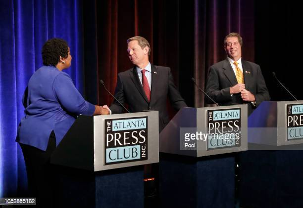 Georgia gubernatorial candidates Democrat Stacey Abrams Republican Brian Kemp and Libertarian Ted Metz talk before their debate at Georgia Public...