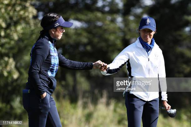 Georgia Hall and Celine Boutier of Team Europe bump fists on the fifteenth green during Day 1 of The Solheim Cup at Gleneagles on September 13 2019...