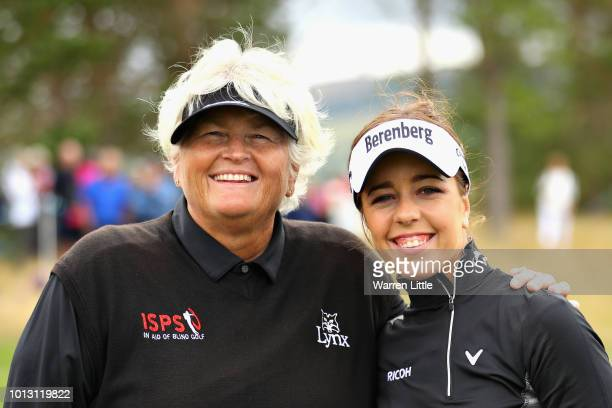 Georgia Hall and Laura Davies of Great Britain pose for a photo on hole fourteen after winning match 1 of Group A during day one of the European Golf...
